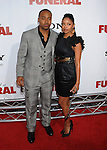 """HOLLYWOOD, CA. - April 12: Columbus Short and guest arrive to the """"Death At A Funeral"""" Los Angeles Premiere at Pacific's Cinerama Dome on April 12, 2010 in Hollywood, California."""