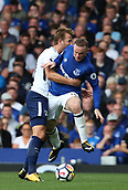 9th September 2017, Goodison Park, Liverpool, England; EPL Premier League Football, Everton versus Tottenham; Harry Kane of Tottenham and Wayne Rooney of Everton tangle as they compete for the ball