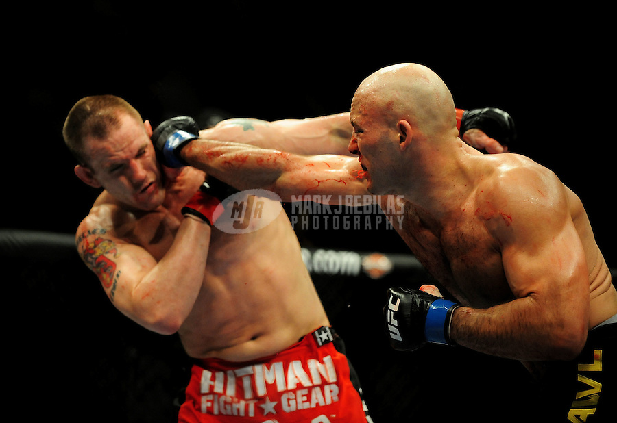 Jan. 31, 2009; Las Vegas, NV, USA; UFC fighter Christian Wellisch punches Jake O'Brien during the light heavyweight bout in UFC 94 at the MGM Grand Hotel and Casino. Mandatory Credit: Mark J. Rebilas-