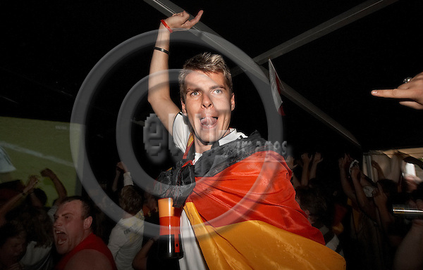 """FRANKFURT AN DER ODER - GERMANY 30. JUNE 2006 -- FIFA World Cup 2006 - Public viewing Island Ziegenwerder - German public celebrating as Germany wins 5-3 (1-1 + 4-2)  agains Argentina  -- PHOTO: CHRISTIAN T. JOERGENSEN / EUP & IMAGES..This image is delivered according to terms set out in """"Terms - Prices & Terms"""". (Please see www.eup-images.com for more details)"""
