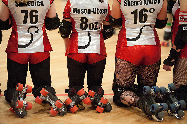 UNITED STATES - OCTOBER 2: The DC Demoncats kneel around the rink as another team is introduced at the DC Armory during the DC Rollergirls season opener in Washington on Saturday, Oct. 2, 2010. (Photo By Bill Clark/Roll Call via Getty Images)
