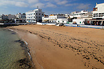 Sandy beach backed by bars and hotels in Corralejo, Fuerteventura, Canary Islands, Spain