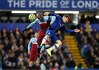 30th November 2019; Stamford Bridge, London, England; English Premier League Football, Chelsea versus West Ham United; Mason Mount of Chelsea being challenged in the air by Angelo Ogbonna of West Ham United - Strictly Editorial Use Only. No use with unauthorized audio, video, data, fixture lists, club/league logos or 'live' services. Online in-match use limited to 120 images, no video emulation. No use in betting, games or single club/league/player publications