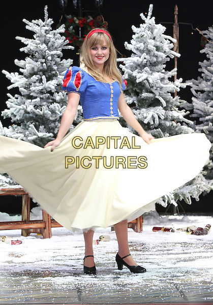 TINA O'BRIEN .First Family Entertainment 2011 Pantomimes Photocall at the Piccadilly Theatre, London, November 26th 2010..panto costume full length snow white dress blue yellow red twirling skirt tulle spinning .CAP/JIL.©Jill Mayhew/Capital Pictures
