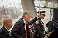 New York Mayor Bill de Blasio, right, and NYPD Commissioner James O'Neill with other high-ranking members of the NYPD brief the media at a press conference on 2016 crime statistics at the Brooklyn Museum on Wednesday, January 4, 2017. 2016 annual shooting incidents fell below 1000 for the first time ever as well as the lowest incidences of reported crime since the introduction of Compstat. (© Richard B. Levine)