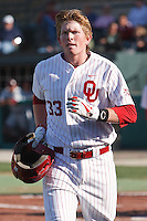 Cameron Seitzer (33) returns to the dugout after hitting a home run during the NCAA matchup between the University of Arkansas-Little Rock Trojans and the University of Oklahoma Sooners at L. Dale Mitchell Park in Norman, Oklahoma; March 11th, 2011.  Oklahoma won 11-3.  Photo by William Purnell/Four Seam Images