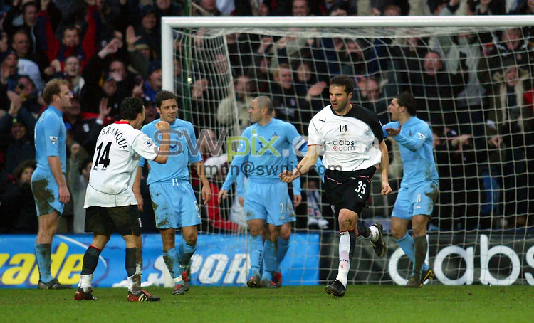 Pix: Rob Matthews/SWpix.com. Soccer. Barclaycard Premiership. Season 2003/2004. Fulham v Tottenham 31/1/2004...COPYWRIGHT PICTURE>>SIMON WILKINSON>>01943 608782>>..Ian Pierce celebrates after Fulham's second goal, as the Spurs players berate each other over their lack defense..