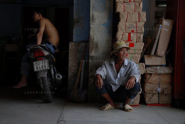 Workers take a break from their construction jobs in Ho Chi Minh City, Vietnam.