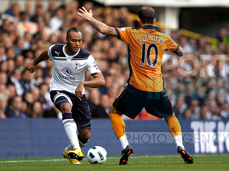 Younes Kaboul of Tottenham Hotspur takes on Steven Fletcher of Wolverhampton Wanderers