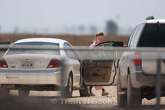 "Eldorado - Young FLDS woman leaving civic center in small car during raid on the FLDS YFZ ""Yearning for Zion"" compound outside of Eldorado, Texas, Saturday, April 5, 2008. CPS"