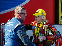 Feb 25, 2018; Chandler, AZ, USA; NHRA funny car driver Courtney Force (right) is congratulated by Tommy Johnson Jr after winning the Arizona Nationals at Wild Horse Pass Motorsports Park. Mandatory Credit: Mark J. Rebilas-USA TODAY Sports