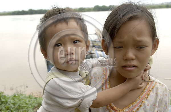 Hanoi-Vietnam, Ha Noi - Viet Nam - 24 July 2005---A group of internal (illegal) migrants / displaced homeless people live on the banks of the Red River in floating huts under miserable conditions, earning little money from begging and waste recycling; here, portrait of a boy and a girl, brother and sister---housing, people, poverty---Photo: Horst Wagner/eup-images