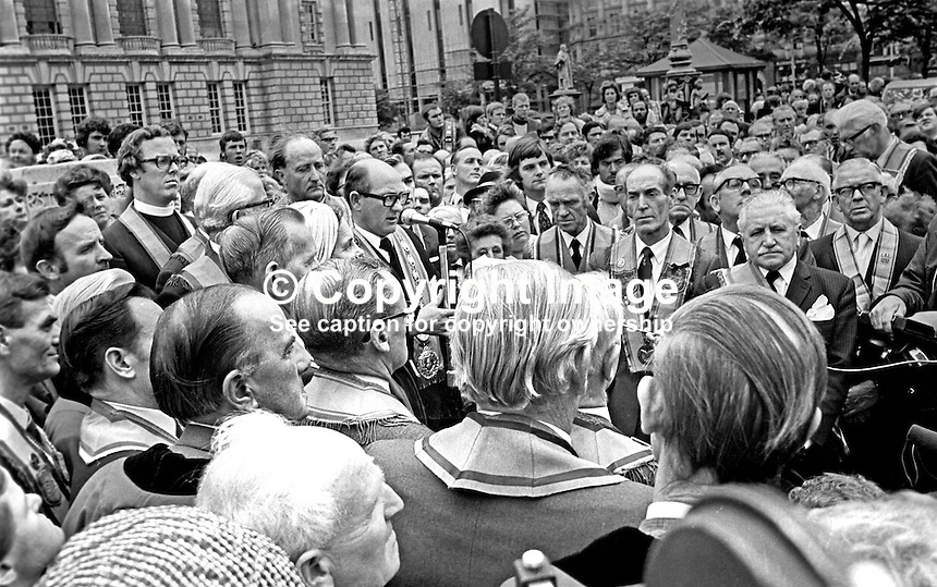Thomas Passmore, Grand Master, Belfast Orangemen, addresses a memorial service in the grounds of Belfast City Hall, 4th September 1975, timed to coincide with the funerals of murdered Orangemen in South Armagh.  The clergyman on the left is Rev Robert Bradford, a Vanguard Unionist MP, who himself was to be assasinated by the Provisional IRA on 14th November 1981. The South Armagh Orangemen who died were Nevin McConnell, William Ronald McKee and James McKee.  197509040630<br />
