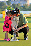 30 August 2009: Heath Slocum shares his trophy with his daughter after winning The Barclays PGA Playoffs at Liberty National Golf Course in Jersey City, New Jersey.