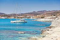 Boats in the emerald water of Prassa in Kimolos, Greece