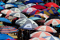 Huntington Beach, CA - Sunday August 06, 2017: Sea of Vans umbrellas during a World Surf League (WSL) Qualifying Series (QS) Championship Final heat in the 2017 Vans US Open of Surfing on the South side of the Huntington Beach pier.