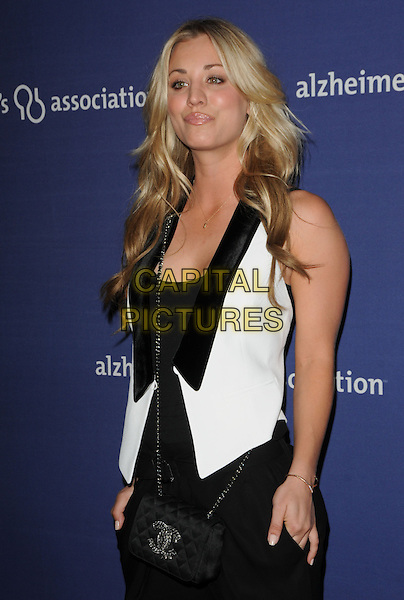 "KALEY CUOCO .at The 18th Annual ""A Night at Sardi's"" Fundraiser & Awards Dinner held at The Beverly Hilton Hotel in The Beverly Hills, California, USA, March 18th 2010..half length black and white waistcoat black top trousers Chanel cross body strap bag hands in pockets sleeveless vest                                                           .CAP/RKE/DVS.©DVS/RockinExposures/Capital Pictures."