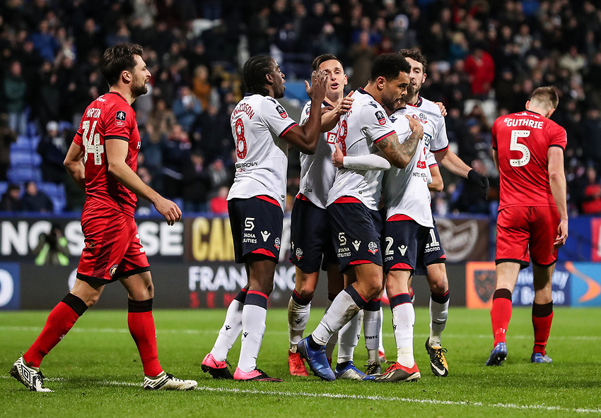 Bolton Wanderers' Josh Magennis celebrates scoring his side's second goal with his team mates<br /> <br /> Photographer Andrew Kearns/CameraSport<br /> <br /> Emirates FA Cup Third Round - Bolton Wanderers v Walsall - Saturday 5th January 2019 - University of Bolton Stadium - Bolton<br />  <br /> World Copyright © 2019 CameraSport. All rights reserved. 43 Linden Ave. Countesthorpe. Leicester. England. LE8 5PG - Tel: +44 (0) 116 277 4147 - admin@camerasport.com - www.camerasport.com