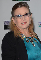 27 December 2016 - Carrie Fisher, the iconic actress who portrayed Princess Leia in the Star Wars series, died Tuesday following a massive heart attack. Carrie Frances Fisher an American actress, screenwriter, author, producer, and speaker, was the daughter of singer Eddie Fisher and actress Debbie Reynolds. File Photo: 19 February 2015 - Santa Monica, Ca - Carrie Fisher. Arrivals for the Oscar Wilde US-Ireland Alliance Pre-Academy Award event held at Bad Robot. Photo Credit: Birdie Thompson/AdMedia