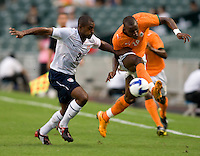 US defender (2) Marvell Wynne moves in on Ivory Coast forward (18) Sekou Cisse during the game at Hong Kong Stadium.  The US Men's Olympic team tied Ivory Coast, 0-0, during the ING Cup in Hong Kong.