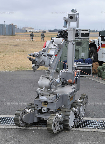 April 9, 2011, Tokyo, Japan - A radio-controlled robot is deployed by U.S. Marines from the Chemical Biological Incident Response Force in a radioactive decontamination drill alongside members of Japan Self-Defense Forces at Yokota Air Base in Tokyo on Saturday, April 9, 2011. Based at the Indian Head Naval Surface Warfare Center in Maryland, CBIRF members are specially trained to counter the effects of chemical, biological, radiological, nuclear or high-yield explosives. The US team will remain at the airbase until assistance is requested by Japan to battle problems at the troubled nuclear plant located some 200 km northeast of Tokyo, which has been spewing radiation since it was swamped by the tsunami on March 11. (Photo by AFLO) [3620] -mis-