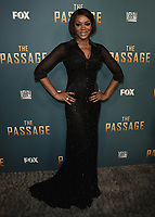 "SANTA MONICA - JANUARY 10:  Caroline Chikezie at the red carpet premiere party for FOX's ""The Passage"" at The Broad Stage on January 10, 2019, in Santa Monica, California. (Photo by Scott Kirkland/Fox/PictureGroup)"