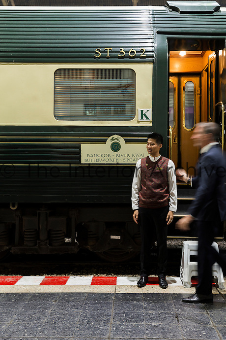 Travelling in style on the Eastern & Orient Express from Bangkok to Singapore. Guests get ready to board at Hua Lamphong station.
