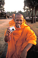 Monk with Camera and Cigarette at World's Largest Temple, Angkor Wat Siem Reap, Cambodia