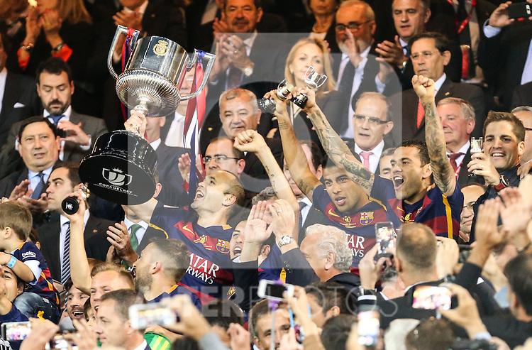 FC Barcelona's Andres Iniesta, stand up the trophy, with Rafinha and Daniel Alves  during Spanish Kings Cup Final match. May 22,2016. (ALTERPHOTOS/Rodrigo Jimenez)