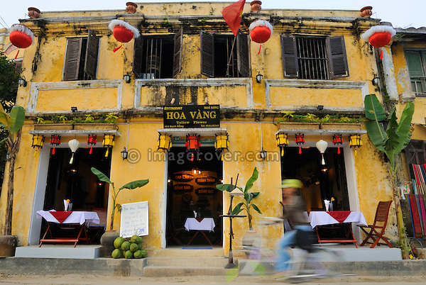 Asia, Vietnam, Hoi An. Hoi An old quarter. Restaurant Hoa Vang, Yellow Flower. The historic buildings, attractive tube houses, and decorated community halls have 1999 earned Hoi An's old quarter the status of a UNESCO World Heritage Site. To protect the old quarter's character stringent conversation laws prohibit alterations to buildings, as well as the presence of cars on the roads.