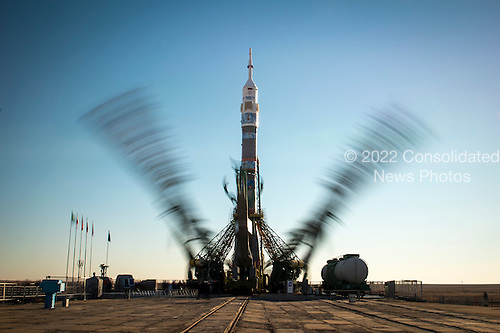 The Soyuz TMA-11M rocket, adorned with the logo of the Sochi Olympic Organizing Committee and other related artwork, is seen in this long exposure photograph, as the service structure arms are raised into position at the launch pad on Tuesday, Nov. 5, 2013, Baikonur Cosmodrome in Kazakhstan. Launch of the Soyuz rocket is scheduled for November 7 and will send Expedition 38 Soyuz Commander Mikhail Tyurin of Roscosmos, Flight Engineer Rick Mastracchio of NASA and Flight Engineer Koichi Wakata of the Japan Aerospace Exploration Agency on a six-month mission aboard the International Space Station.  <br /> Mandatory Credit: Bill Ingalls / NASA via CNP