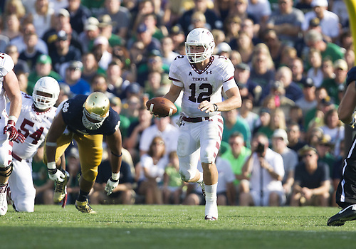 August 31, 2013:  Temple quarterback Connor Reilly (12) runs for yardage during NCAA Football game action between the Notre Dame Fighting Irish and the Temple Owls at Notre Dame Stadium in South Bend, Indiana.  Notre Dame defeated Temple 28-6.