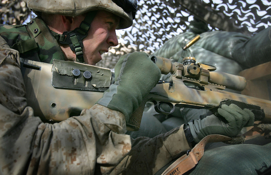 Marine scout-sniper Sgt. Ian Jennings puts a round through the chest of an insurgent during an attack on the Al-Anbar provincial Government Center on Saturday, Jan. 15, 2005 in Ramadi, Iraq. The Government Center houses the office of the provincial governor and administration.