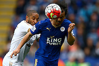 Ashley Williams of Swansea City and Shinji Okazaki of Leicester City in action during the Barclays Premier League match between Leicester City and Swansea City played at The King Power Stadium, Leicester on 24th April 2016