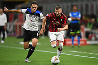 Rafael Toloi of Atalanta BC and Ante Rebic of AC Milan compete for the ball during the Serie A football match between AC Milan and Atalanta BC at stadio Giuseppe Meazza in Milano ( Italy ), July 24th, 2020. Play resumes behind closed doors following the outbreak of the coronavirus disease. <br /> Photo Image Sport / Insidefoto
