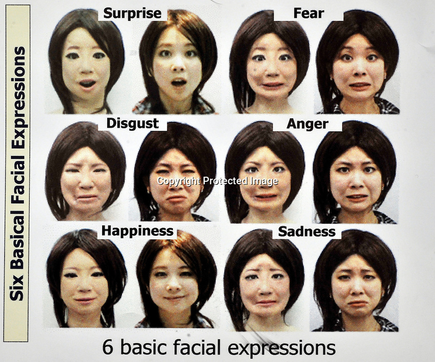 Some expressions of SAYA next to the student from whom she was modelled at the Tokyo Science University 15th FEB 2009..The humanoid, which can talk and has unlimited facial expressions is being introduced as a teacher for primary schools children and just underwent a succesful pilot run at Kudan Primary in central Tokyo...photo by Richard Jones...photo by Richard Jones