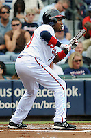 Atlanta Braves left fielder Jose Constanza #13 square to bunt during a game against the Colorado Rockies at Turner Field on September 3, 2012 in Atlanta, Georgia. The Braves  defeated the Rockies 6-1. (Tony Farlow/Four Seam Images).