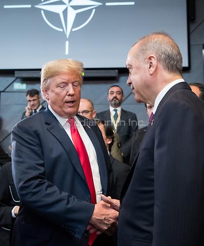 11 July 2018, Brussels, Belgium: Donald Trump, President of the United States of America, and Recep Tayyip Erdogan, President of Turkey, greet each other at the first work session of the North Atlantic council at the NATO Summit. From 11 July 2018 until 12 July 2018 government heads of the 29 NATO member states and European Union representatives, will participate in the Summit of the North Atlantic Treaty Organization. Photo: Bernd von Jutrczenka/dpa /MediaPunch ***FOR USA ONLY***