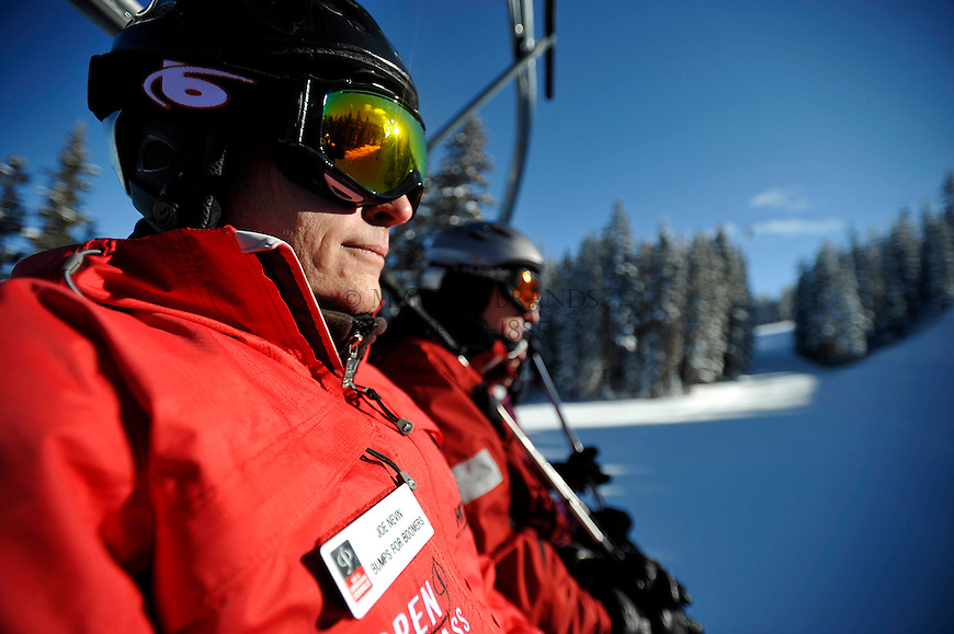 Bumps for Boomers instructor Joe Nevins rides the chair lift up Aspen Mountain. Michael Brands for The New York Times.