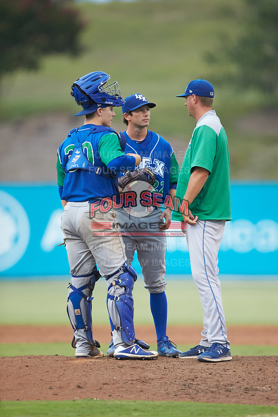 Lexington Legends pitching coach Mitch Stetter (right) has a meeting on the mound with relief pitcher Brandon Marklund (22) and catcher Nick Hutchins (30) during the game against the Kannapolis Intimidators at Kannapolis Intimidators Stadium on August 4, 2019 in Kannapolis, North Carolina. The Legends defeated the Intimidators 5-1. (Brian Westerholt/Four Seam Images)
