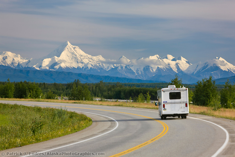 Motor home travels the Richardson Highway,  against the backdrop of the Alaska range, just south of Fairbanks, interior, Alaska.