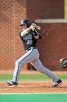 John McNulty (30) of the Coastal Carolina Chanticleers follows through on his swing against the High Point Panthers at Willard Stadium on March 15, 2014 in High Point, North Carolina.  The Chanticleers defeated the Panthers 1-0 in the first game of a double-header.  (Brian Westerholt/Four Seam Images)