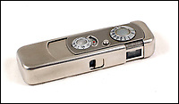 BNPS.co.uk (01202 558833)Pic: Astons/BNPS<br /> <br /> Legendary Minox mini camera - made in Latvia.<br /> <br /> Cold War Collectables - Auction of Soviet spy camera's from behind the Iron Curtain reveal the KGB's cunning and ingenuity at the height of the Cold War.<br /> <br /> A fascinating collection of Russian spy cameras which were used clandestinely at the height of the Cold War have emerged for sale for &pound;60,000.<br /> <br /> The ingenious gadgets deployed by KGB operatives include cameras built into the sides of briefcases, buttons of jackets, umbrella handles and cigarette cases.<br /> <br /> The sale also features a clever 'Zenit' F-21 spy camera which shoots photos through the side of a camera case when it appears to be shut.<br /> <br /> There are also several 'Minox' cameras which are known as the 'James Bond' spy camera as one appeared in the film On Her Majesty's Secret Service (1969).