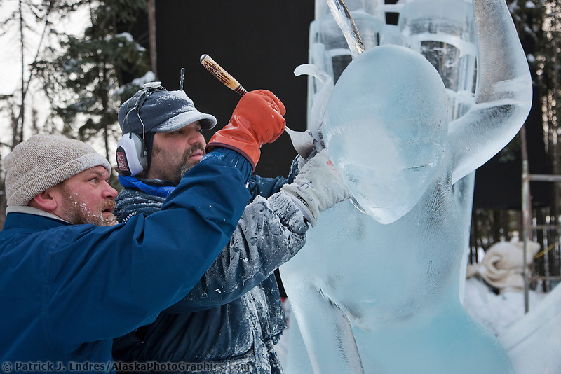 "Ice artists Vladimir Zhikhartsev and Aaron Costic work on ""Pandoras Box"" a multi-block sculpture that earned first place in the abstract category, 2009 World Ice Art Championships, Fairbanks, Alaska"