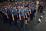 Philippine National Police stand at attention at the PNP's Camp Crame.
