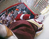 The officials intervene after Tim Kunes (BC 6) and Matt McCollem (Harvard 23) join John Muse (BC 1) in the net. The Boston College Eagles defeated the Harvard University Crimson 6-5 in overtime on Monday, February 11, 2008, to win the 2008 Beanpot at the TD Banknorth Garden in Boston, Massachusetts.