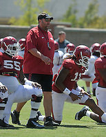 NWA Democrat-Gazette/MICHAEL WOODS &bull; @NWAMICHAELW<br /> University of Arkansas coach Bret Bielema watches the team warm up during practice Thursday, August 20, 2015 in Fayetteville.