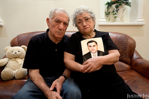 Asya Semenovna Abramian, 75, and her husband Georgy Saakovich Abramian, 76, with a portrait of their son Karen Abramian at home in Moscow. Karen Abramian, an ethnic Armenian, was stabbed to death by far right youths in front of his apartment block in Moscow. .Picture by Justin Jin.