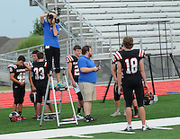 NWA Democrat-Gazette/FLIP PUTTHOFF<br /> PEA RIDGE PICTURE DAY<br /> Joseph Ortiz with the Pea Ridge Blackhawks high school football team has his picture taken Wednesday August 6 2015 by Shandi Knighting (cq) with Lifetouch photography. Football players had their portaits and team photo made Wednesday morning at the football stadium.