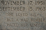 "The grave marker of Denise McNair stands in Elmwood Cemetery in Birmingham, Alabama. She was one of four girls killed in a bombing at 16th Street Baptist Church September 15, 1963. The tombstone is inscribed with ""She loved all--but a mad bomber hated her kind."""
